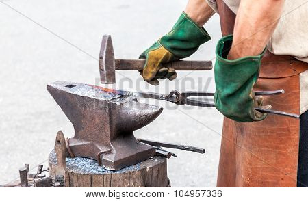 Blacksmith Making A Decorative Element On The Anvil