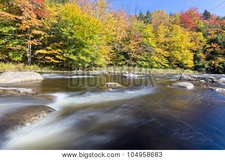 Fast flowing river during the autumn long exposure