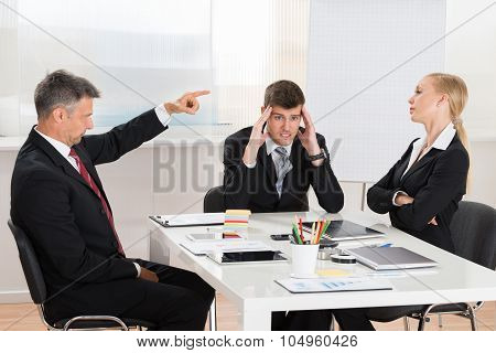 Businessman Arguing With His Two Co-workers