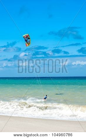 Active lifestyle sport background. Kite surfer near ocean coast beach