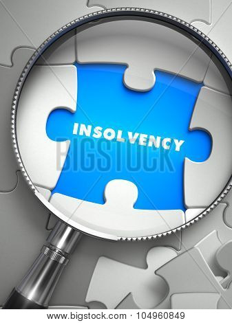 Insolvency - Missing Puzzle Piece through Magnifier.