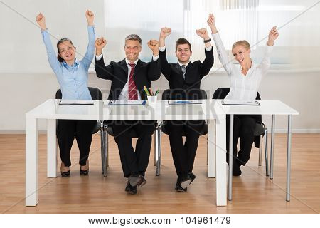Excited Businesspeople In Office