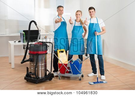 Janitors With Vacuum Cleaner And Cleaning Equipments