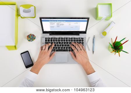 Businessperson Banking Online On Laptop