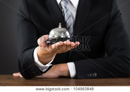 Businessperson Hands Holding Service Bell