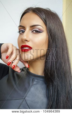 Oriental style. Sensual arabic woman model. Beautiful clean skin, saturated makeup. Bright eye make-up and dark eyeliner