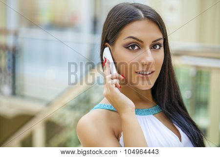 Sexy young woman calling by phone. Oriental style. Sensual arabic girl model