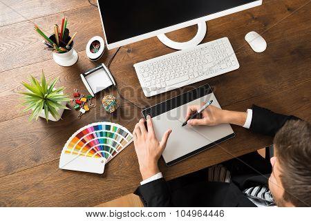 Male Designer Using Digital Graphic Tablet