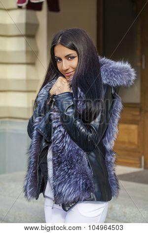 Oriental style. Sensual arabic woman model. Beautiful young girl in fur coat