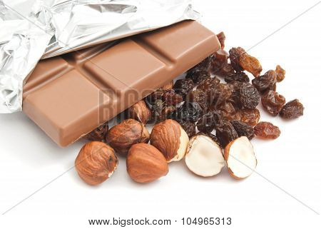 Some Hazelnuts, Raisins And Chocolate Bar
