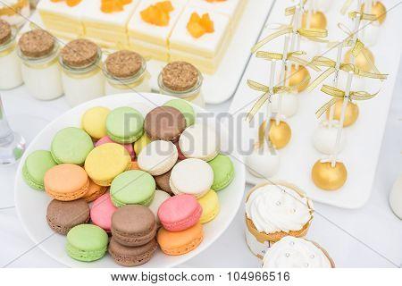 French Macaroons. Coffee, Chocolate, Vanilla And Raspberry Macaroons