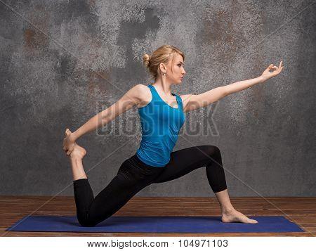Young Woman Doing Yoga Asana
