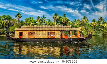 Travel tourism Kerala background - panorama of tourist houseboat on Kerala backwaters. Kerala, India