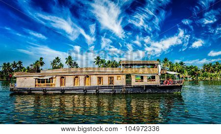 Kerala India  travel background - panorama of tourist houseboat on Kerala backwaters. Kerala, India