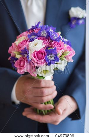 Groom Hold Wedding Bouquet In Hand