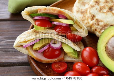 homemade tortillas pita stuffed with vegetables and meat