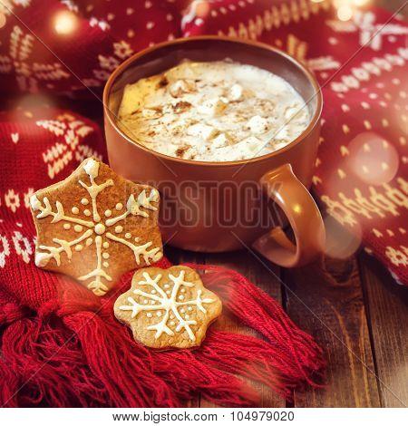 mug with hot chocolate and red christmas scarf