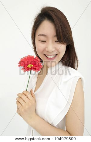 Beautiful asian woman with red flower
