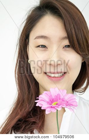 Beautiful asian woman with pink flower