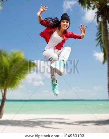 sport, dancing and urban culture concept - beautiful dancing girl jumping
