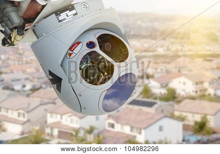 Closeup of A Drone Wing Camera and Sensor Pod Module Above A Residential Neighborhood.