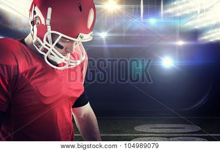 Close up view of american football player focusing against american football arena
