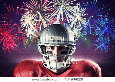 Portrait of determined sportsman against fireworks exploding over football stadium
