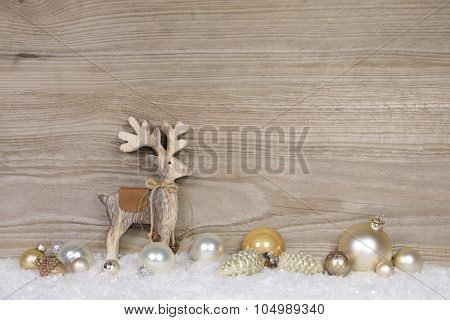 Country style christmas decoration for a greeting card with wood and snow.