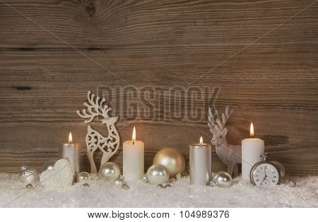 Nostalgic golden, brown and white wooden christmas background with four advent candles for christmas decoration.
