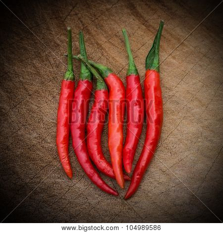 Fresh And Spicy Cayenne On A Wooden Chop Board