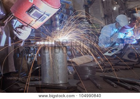 Sparks While Welder Uses Torch To Welding