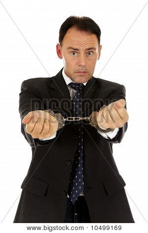 Middle Aged Businessman Handcuffs