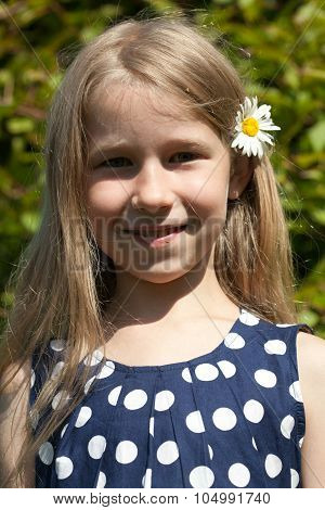 Young Girl With Camomile Flower In The Hair