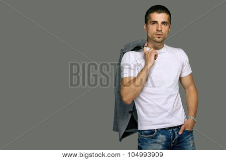 man in a white T-shirt and jeans, studio