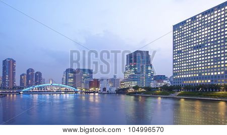 Tokyo city view with high rise building and sumida river in evening