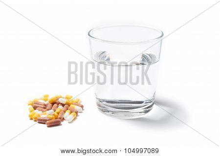 Pills Capsules Of Medicament Isolated On White Background With W