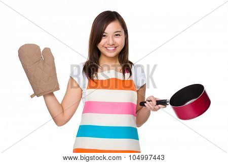 Young housewife raise up with saucepan