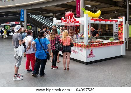 People Waiting For Sweets Kiosk At Central Station Antwerp, Belgium