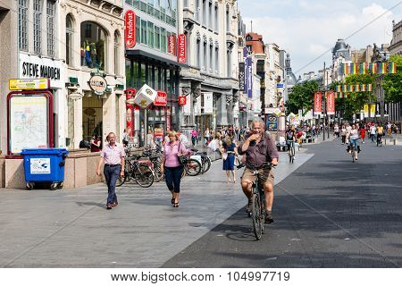 People And Cyclists In Main Shopping Street Of Antwerp, Belgium