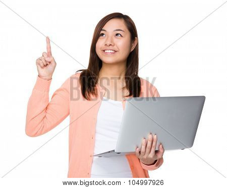 Asian woman use of the laptop computer and finger point up