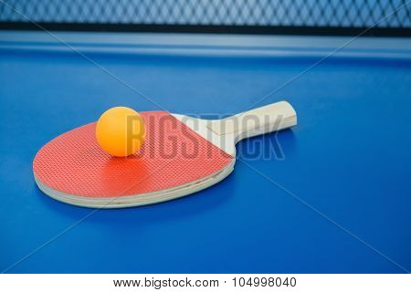 Pingpong Racket And Ball On A Blue Pingpong Table