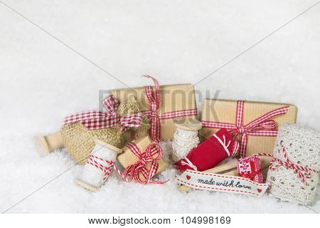 Handmade christmas presents with sewing utensils in red and white colors.