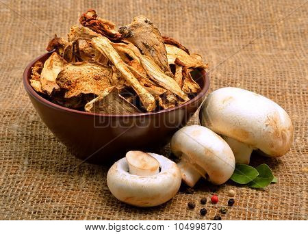 Mushrooms, Ceps And Raw Champignons On The Sacking Background