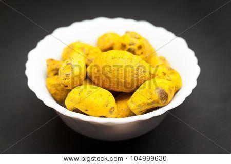 Organic Round Turmeric in white bowl.