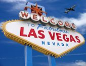 image of las vegas casino  - welcome to las vegas sign with plane flying overhead in las vegas  - JPG
