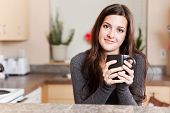 picture of coffee-cup  - A shot of a young woman holding a cup of coffee - JPG