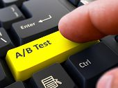 Постер, плакат: AB Test Concept on Yellow Keyboard Button