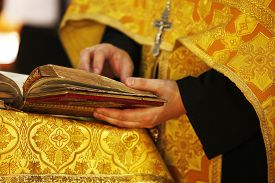 foto of priest  - The Bible in hands of the priest - JPG
