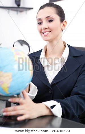 Businesswoman With Desk Globe