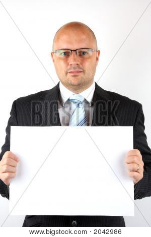 Businessman Holding A Blank Sign For Your Message